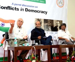 Congress leaders Kapil Sibal and Sanjay Jha with former Advocate General of Maharashtra Shrihari Aney during a panel discussion on 'Conflicts in Democracy', in Nagpur on Aug 18, 2018.