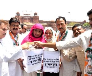 Congress leaders led by Delhi party chief Ajay Maken holds a protest to save Red Fort in view of the Union Government's recent agreement with a private company for its upkeeping, in New ...