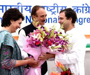 Congress leaders Priyanka Gandhi and Ghulam Nabi Azad wish party's President Rahul Gandhi on his birthday, in New Delhi, on June 19, 2019.