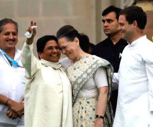 Congress leaders Rahul Gandhi and Sonia Gandhi with BSP chief Mayawati during the swearing-in ceremony of Karnataka Chief Minister H.D. Kumaraswamy, at Vidhana Soudha in Bengaluru on May ...