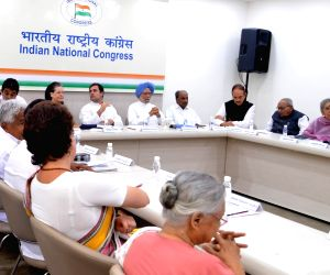 Congress leaders Sheila Dikshit, Priyanka Gandhi Vadra, Jyotiraditya Scindia, Oommen Chandy, Ahmed Patel, Mallikarjun Kharge, K. C. Venugopal, Sonia Gandhi, Rahul Gandhi, Manmohan Singh, ...