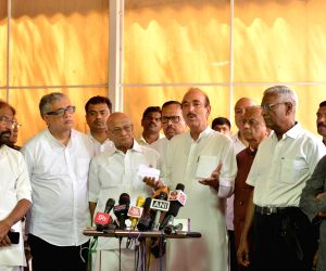 Congress MP Ghulam Nabi Azad along with party MP Anand Sharma, Trinamool Congress MP Derek O'Brien, CPI MP D. Raja, AAP MP Sanjay Singh, RJD MP Manoj Jha and other opposition leaders, ...