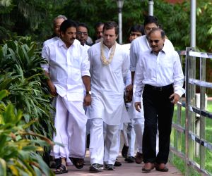 Congress President Rahul Gandhi accompanied by party leader K. C. Venugopal and Rajasthan Chief Minister Ashok Gehlot arrives at the party's headquarters to celebrate his birthday with ...