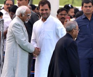 Congress President Rahul Gandhi, former President Pranab Mukherjee and former Vice President Mohammad Hamid Ansari during a ceremony to pay homage to former Prime Minister Rajiv Gandhi on ...