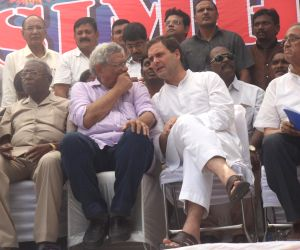 Congress President Rahul Gandhi in a conversation with CPI-M General Secretary Sitaram Yechury during a protest organised over the SC/ST Atrocities Bill, at Jantar Mantar in New Delhi on ...