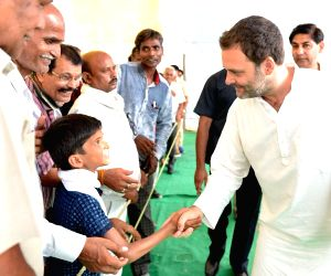 Congress President Rahul Gandhi interacts with farmers during his visit to Shree Mukut Nath Inter College in Tala village of Amethi, Uttar Pradesh on July 5, 2018.