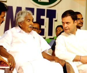 Congress President Rahul Gandhi interacts with party leaders Oommen Chandy and K. C. Venugopal during the Coordination meeting of three parliamentary constituencies of Kannur, Kasaragod and ...