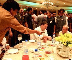 Congress President Rahul Gandhi with Former President Pranab Mukherjee at an iftaar party hosted by him in New Delhi on June 13, 2018.