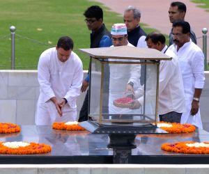 Congress President Rahul Gandhi with party leaders Ajay Maken, Ashok Gehlot and Haroon Yusuf pay homage at the Samadhi of Mahatma Gandhi, at Rajghat during the Congress' day-long ...