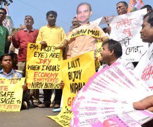 Congress workers burn effigies of Nirav Modi, Vijay Mallya and Lalit Modi during a demonstration in Kolkata, on Feb 18, 2018.