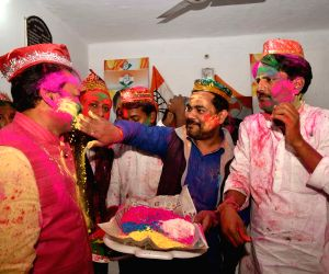 Congress workers celebrate Holi at the party's headquarters in Patna on Mar 1, 2018.
