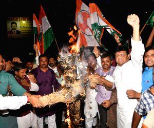 Congress workers led by Bihar Congress Working President Kaukab Qadri burn the effigy of Union Finance Minister Arun Jaitley after Vijay Mallya, the fugitive liquor baron, wanted in India for ...