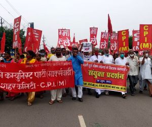 CPI(M) activists hold placards take out a protest march against petrol and diesel price hike, in Patna, Wednesday, June 30, 2021.