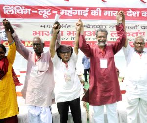 CPI-ML General Secretary Dipankar Bhattacharya with party workers during a party rally, in Patna, on Sept 27, 2018.
