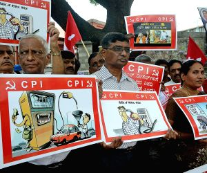 CPI workers stage a demonstration against hike in fuel prices in Bengaluru, on June 20, 2018.