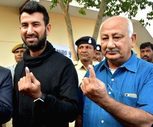 Rajkot (Gujarat): Cheteshwar Pujara, Arvind Pujara vote during the first phase of Gujarat election
