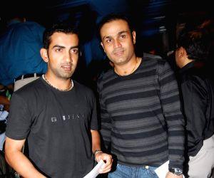 Cricketer Gautam Gambhir and Virender Sehwag at the CEAT Awards.