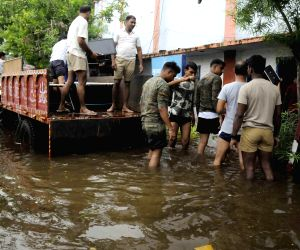 CRPF soldiers leave their flooded camp