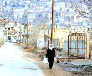 SYRIA-ZABADANI-WAR-RAVAGED CITY-FAMILIES-RETURNING