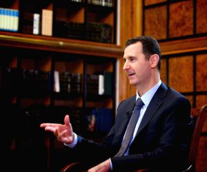 Syrian President Bashar al-Assad receives an interview with Russia 24 channel in Damascus
