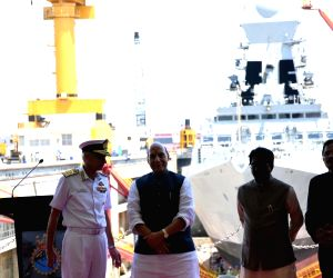 Defence Minister Rajnath Singh, Navy Chief Admiral Karambir Singh and MoS Defence Shripad Yesso Naik during the commissioning ceremony of India's second Scorpene-class attack submarine INS ...