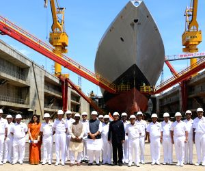 Defence Minister Rajnath Singh with senior officials of Indian Navy at the inauguration of the Aircraft Carrier Dry Dock, at Naval Dockyard, in Mumbai on Sep 28, 2019.