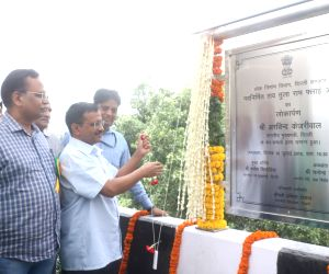Delhi Chief Minister Arvind Kejriwal and Public Works Department Minister Satyendra Kumar Jain unveil the plaque to inaugurate the newly constructed Rao Tula Ram (RTR) Flyover at Outer ...