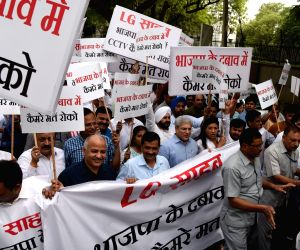 Delhi Chief Minster Arvind Kejriwal, Deputy Chief Minister Manish Sisodia and other AAP legislators stage a demonstration near the office of the Lieutenant Governor (LG) Anil Baijal after ...