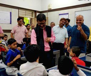 Delhi Deputy Chief Minister and Education Minister Manish Sisodia and Meghalaya Education Minister Lahkmen Rymbui interact with children during their visit to Sarvodaya Vidyalaya, Rouse ...