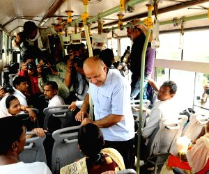 Delhi Deputy Chief Minister Manish Sisodia interacts with a woman passenger regarding the Delhi Government's plan to offer free Delhi Metro and DTC bus rides for women in the Capital; on ...