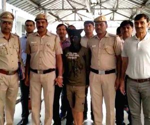Delhi Police present before the press an accused identified as Gaurav alias Nonu from Haryana's Sonepat for robbing Prime Minister Narendra Modi's niece Damyanti Ben Modi, in New Delhi, on ...