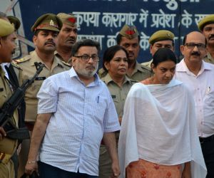 Dentist couple Rajesh and Nupur Talwar walk out of Dasna jail in Ghaziabad after Allahabad High Court acquitted them of the murder of their 14-year-old daughter Aarushi and domestic help ...