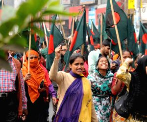 Garment workers attend a protest rally with Bangladeshi flags demanding detention of the owner of the Tazreen Fashion Limited garment factory in Dhaka