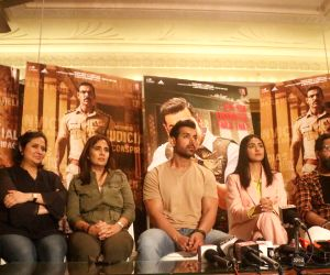 Director Nikhil Advani, producers Bhushan  Kumar,  Monisha Advani, Madhu Bhojwani and actors John Abraham and Mrunal Thakur. (Photo: Bidesh Manna/IANS)
