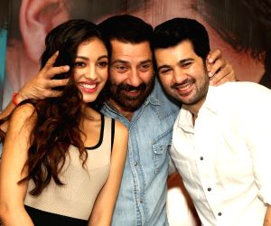 """Director Sunny Deol with actors Karan Deol and Sahher Bambba during the promotions of their upcoming film """"Pal Pal Dil ke Pass"""" in New Delhi on Sep 17, 2019."""