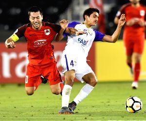 DOHA, April 17, 2018 - Rayan Yslam Al Jaberi of Al Ain FC vies for the ball with Rodrigo Tabata (L) of Al Rayyan during the AFC Champions League Group D soccer match between Qatar's Al Rayyan SC and ...