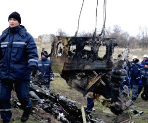 Donetsk (Ukraine): Workers work on the site where the MH17 plane of Malaysia Airlines crashed