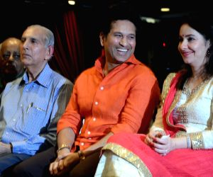 """Dr. Yashwant Ambdekar with Cricket legend Sachin Tendulkar and wife Anjali Tendulkar during the launch of his book """"Even when there is a Doctor"""" in Mumbai on Feb 8, 2018."""