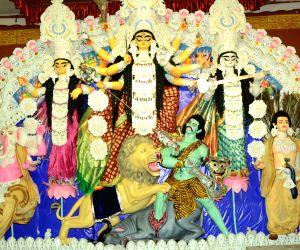Corona is the new Mahishasura in Delhi's subdued Durga Puja