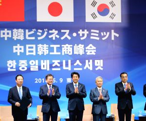 ers and business representatives of South Korea, China and Japan attend a trilateral business summit in Tokyo on May 9, 2018. The three countries agreed to cooperate for a three-way free ...