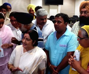 Sushma Swaraj, Harsimrat Kaur Badal meet family members of Indians trapped in Iraq