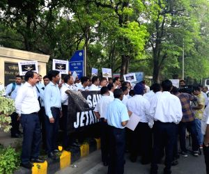 Faced with the prospect of job loss, the employees of grounded Jet Airways stage a protest march in front of Rajiv Gandhi Bhawan that houses the Civil Aviation Ministry, in New Delhi on ...