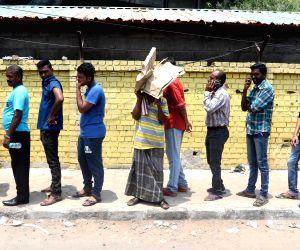 Fans throng M. A. Chidambaram Stadium in Chennai to buy IPL 2018 tickets on April 2, 2018.