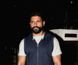 Farhan Akhtar hits back at a troll who criticised him for 'using his status for vaccination'; actor says, 'do something constructive for society'