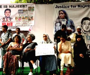 Fatima Nafis (C), mother JNU student Najeeb Ahmad, social activist Arundhati Roy during a protest on the completion of 3 years of the disappearance of a 26 years old JNU student Najeeb ...