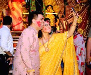 Filmmaker Karan Johar and actress Kajol pose for selfies during Vijaya Dashami celebrations, in Mumbai on Oct 8, 2019.