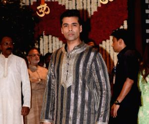 Filmmaker Karan Johar arrives at Reliance Industries Chairman and MD Mukesh Ambani's residence to celebrate Ganesh Chaturthi in Mumbai on Sept 13, 2018.