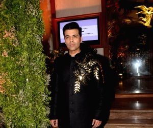 Karan Johar at a wedding reception