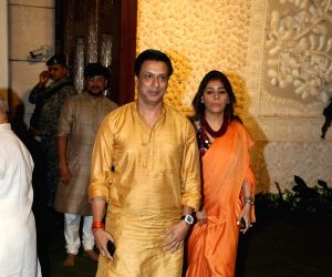 Filmmaker Madhur Bhandarkar with his wife Renu Namboodiri at Reliance Industries Ltd. Chairman Mukesh Ambani's residence in Mumbai on Sep 2, 2019.