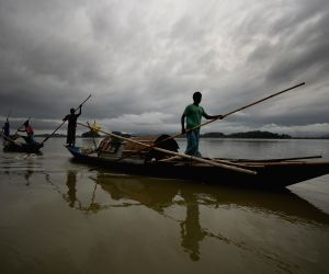 Rain clouds loom over the Brahmaputra river